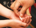 child_communion_hands